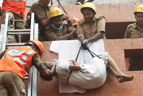 An ICU patient is evacuated from AMRI Hospital, Kolkata