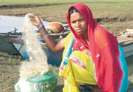After fishing all night, 250 g of commercially worthless chehal is all Rekha could catch. Big fish are a rare catch
