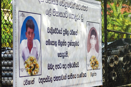 Posters of young men who died of bullet injuries during protest for clean water