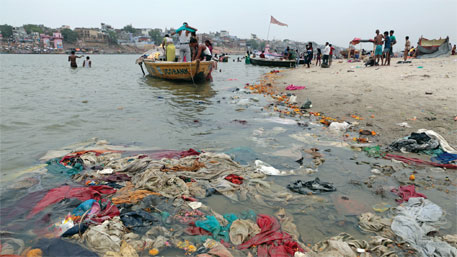 Pilgrims who bathe at Ramnagar Ghat in Varanasi leave behind heaps of garbage