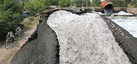 Highly toxic industrial wastewater flows into an irrigation canal at Jajmau, in the suburbs of Kanpur