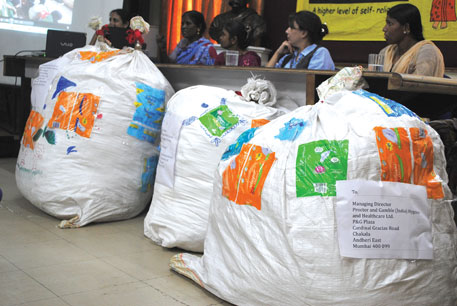 Members of SWaCH at a press conference with bags of soiled sanitary napkins addressed to the manufacturers