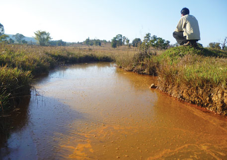 A pond in Chindi Tola filled with acidic mine waste from HCL's tailings dam