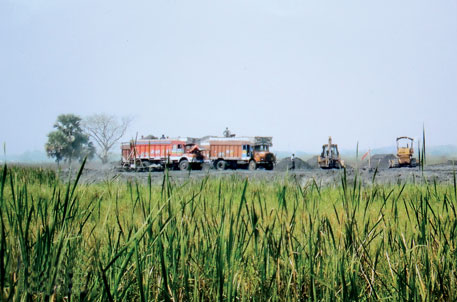 A 2010 photo by activist Tapan Dutta shows wetland being filled with fly ash