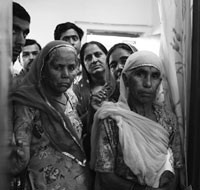 Patients wait outside the doctor's room at RCC