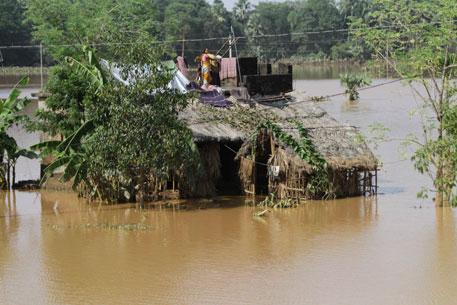 Flood-affected village residents in Jajpur district served food