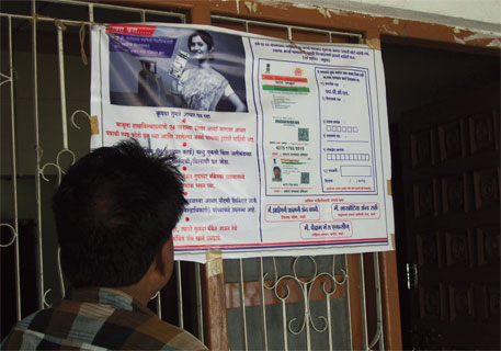 A poster in Wardha giving information on the linkage of cooking gas subsidy with Aadhaar from June 1