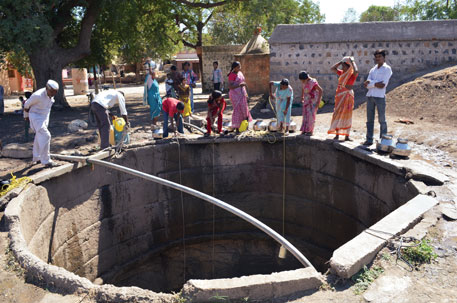 Residents of Hastapokhri in Jalna district draw water from the lone well in the village. It has little more than silt left
