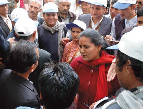 Chapagain moderating elections of electricity user groups in Kathmandu in 2010