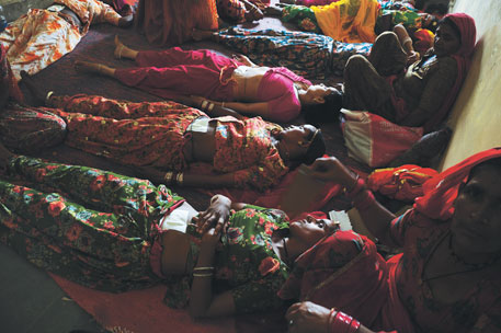 Unconscious women lie at a community health centre in Bikaner, Rajasthan, after undergoing sterilisation operation