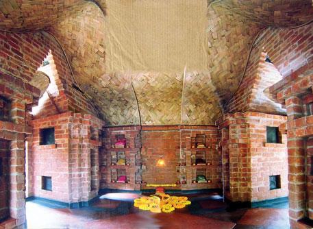 Meditation room for Asha Niketan: exposed bricks and bamboo mesh arches
