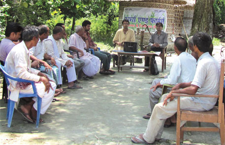 Shashank and Manish discuss market trends with farmers at their office