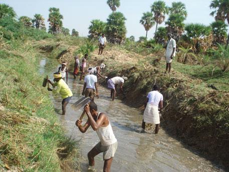 Madirepalli farmers desilt an irrigation channel near their village