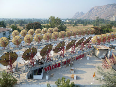 The roof of the kitchen at the Brahma Kumaris World Spiritual University campus has 84 parabolic concentrators to generate solar energy