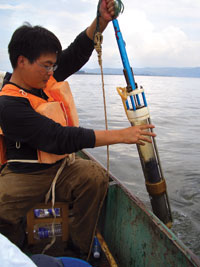 Enlou Zhang, one of the researchers, collects sediment core samples from Lake Erhai in China