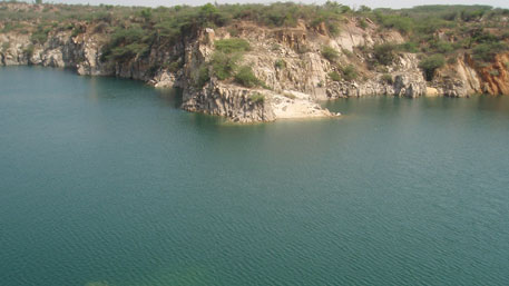 The picturesque Bhardwaj Lake nestled in the Aravallis fills a deep depression left by mining. People say it is named after a mining contractor, but Faridabad's mining lease record has no such name in it