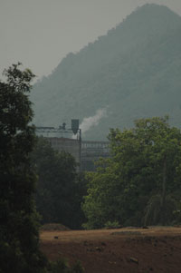 Dongria Kondhs treat the Niyamgiri hills as their god, or Niyam Raja (seen in the backdrop) of the Vedanta refinery