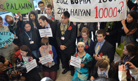 Warsaw climate talks: activists shunted out for showing solidarity with typhoon-hit Philippines