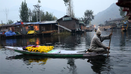 The Dal lake. The natural drainage channels between lakes and wetlands in Srinagar has been destroyed, and the lakes are also silted heavily, diminishing their ability to act as sponges for the city (DTE file photo)