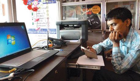 Govind Kevat runs a State Bank of India kiosk at Deori in Madhya Pradesh