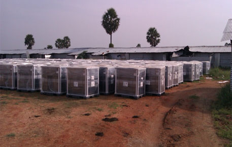 Solar modules in boxes, waiting to be set up at a 5 MW solar plant in Tuticorin, Tamil Nadu, under the National Solar Mission (Photo credit: Joel Kumar)