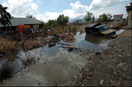 A decade after tsunami, people still await rehabilitation