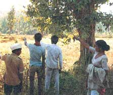 Tribals pointing towards a dam