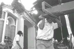 Volunteers remove debris from< (Credit: Moises Castillo /AP)