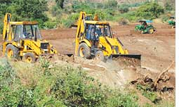 Bulldozers on crop