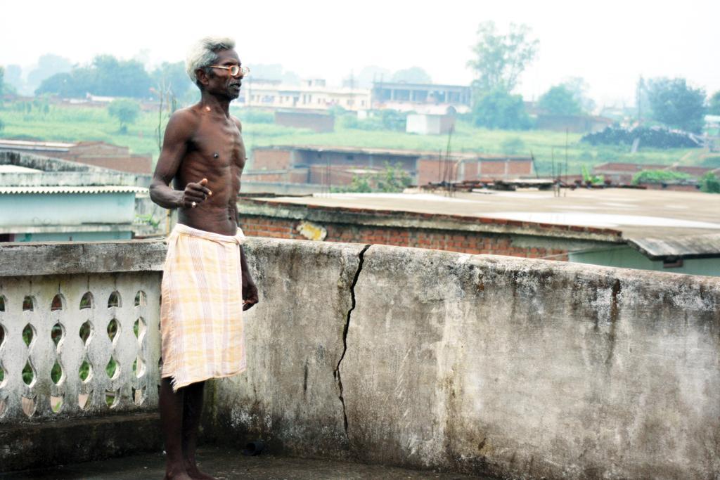 Ramavtar Baiga says blasts at Amlohri mine have created cracks in the walls of his house at the rehabilitation colony (Photographs: Anupam Chakravartty)