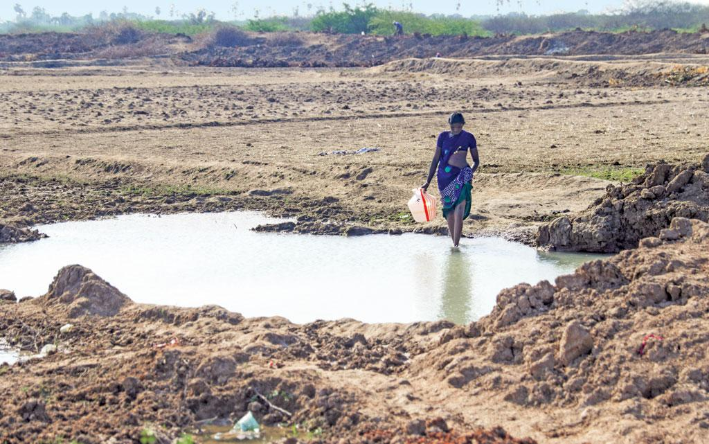 A puddle created by the spillover from a borewell is the only source of free water for the residents of Nagakuri village in the Cauvery delta of Tamil Nadu (Photo  Bhaskarjyoti Goswami)