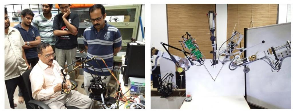 IIT-M team with its trainer robot (left) and slave arms of the robot (right). Credit: India Science Wire
