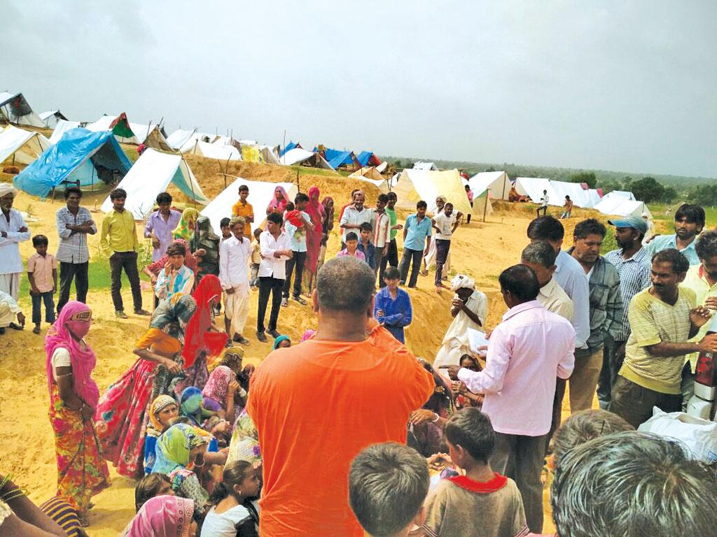 A flood relief camp at Banaskantha, Gujarat. Over 200 people were killed in the state during floods in July (Photo: Belur Math)
