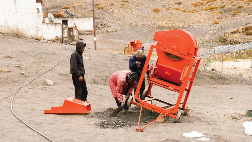 The 15 families in Komik, the world's highest village, recently installed three diesel-guzzling threshers even though reseeding glaciers have reduced their farm yields by a third in the past decade