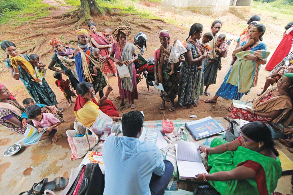 Bonda women and children gather to get immunisation services. Social audits though say that healthcare facilities are poor and irregular