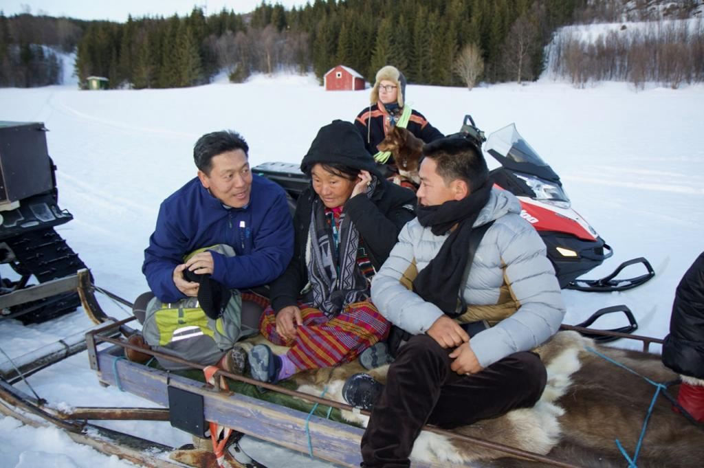 Tashi Dorji (Senior Ecosystems Services Specialist, ICIMOD), Yuden Pem (yak herder from Bhutan) and Shilp Kumar Rai (yak herder from Nepal), with Mikal Juhan Ailo Utsi (reindeer herder from Norway) in the background. Credit: ICIMOD