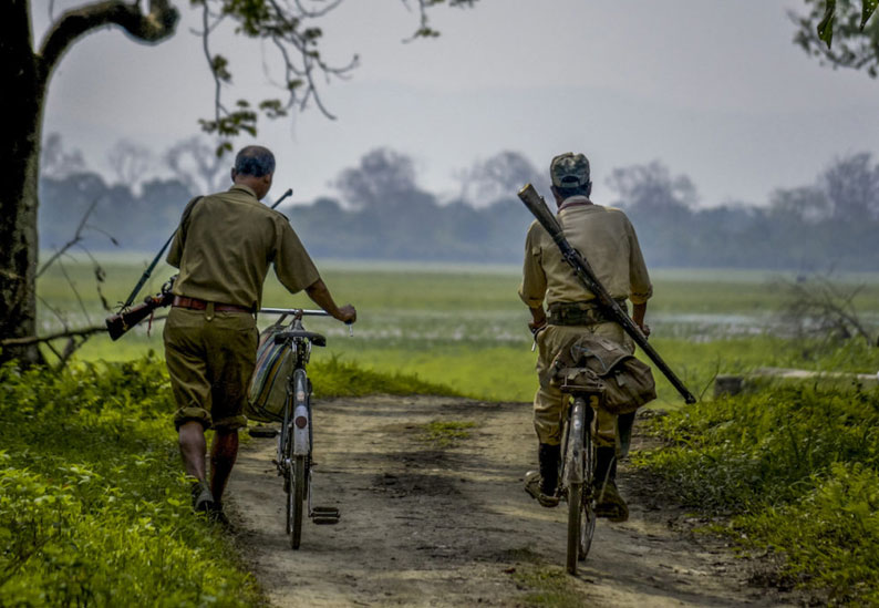 Two forest guards on duty in Manas National Park, which is home to tigers, rhinos, elephants and other threatened and endangered species. Photo by M. Kundal Bora.