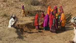 Women MGNREGA workers digging a check dam in Bhanwata village in Alwar district of Rajasthan