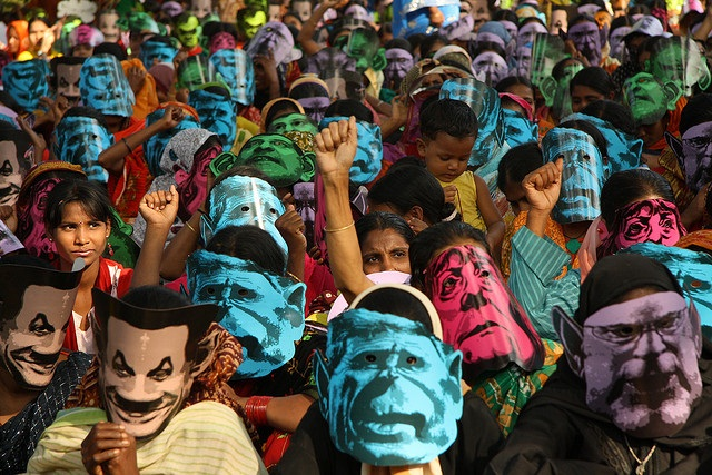 Women at a climate rally in Dhaka. A report says climate change will have a devastating effect on jobs and income Credit: Oxfam International/Flickr