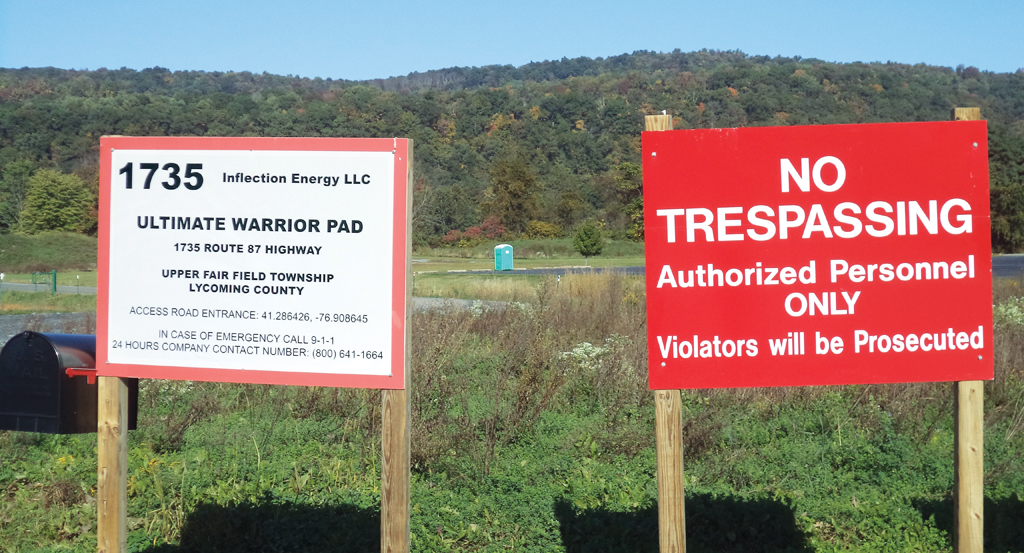Boards put up by shale gas companies to mark their territory. Under Act 13 of Pennsylvania companies can acquire any land for drilling