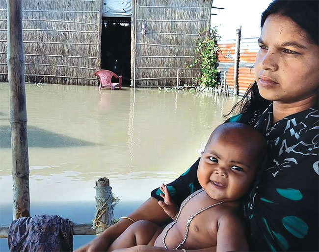 A flood-affected family in Goroimari village in Assam's Kamrup district (JHAI FOUNDATION)