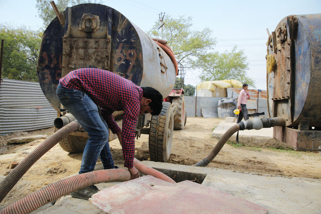 Soak pits at this colony built by a construction company for its workers in Gurgaon have to be emptied every day