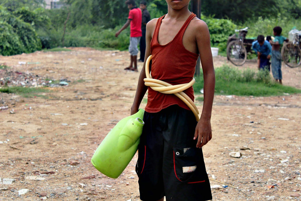 The spirit of jugaad (innovation) is a part of everyday life here. A pipe can be a handy belt to carry another bucket—not to mention a fashion accessory. Survival is a matter of improvisation