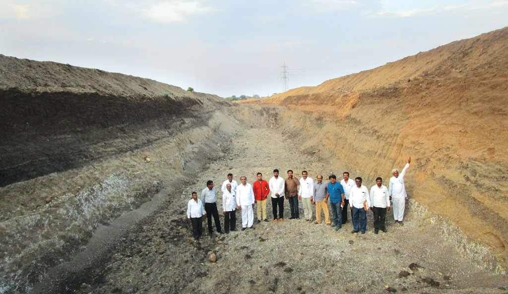 Harangul villagers stand in the