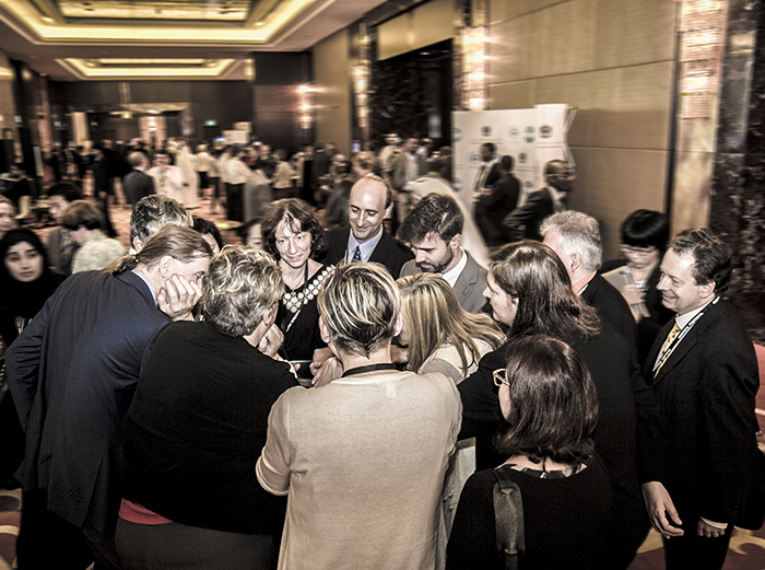 Delegates huddle outside the plenary room on the last day of MOP 27  Credit: IISD