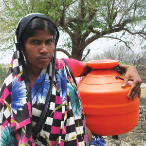 Mamta Devi  of Sonwati village spends hours just filling water from a dugwell near the village temple. She has developed severe neck and back pain because of carrying water up the hillock to her house