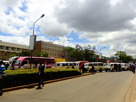 Sixteen-seater matatus seen causing congestion on a city road