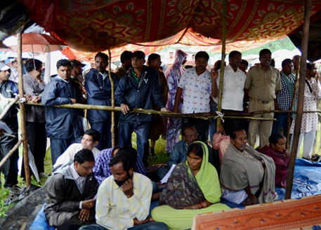 The Goudas sitting inside the Palli Sabha tent (in the foreground) surrounded by media, security personnel, activists and state officials