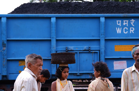 A Dongria Kondh woman at Bissamcuttack railway station. The goods train loaded with coal supplies to the alumina complex of NALCO in Damanjodi, Koraput district