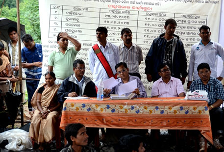Sulochana Gouda, panchayat ward member presiding over the meeting, sat on the extreme left. She protested proposed mining in Niyamgiri. Third from left is district judge Pramod Kumar Jena. To his right is MP Bhakta Charan Das. On the extreme left is a doctor from the district hospital in case of any health emergency
